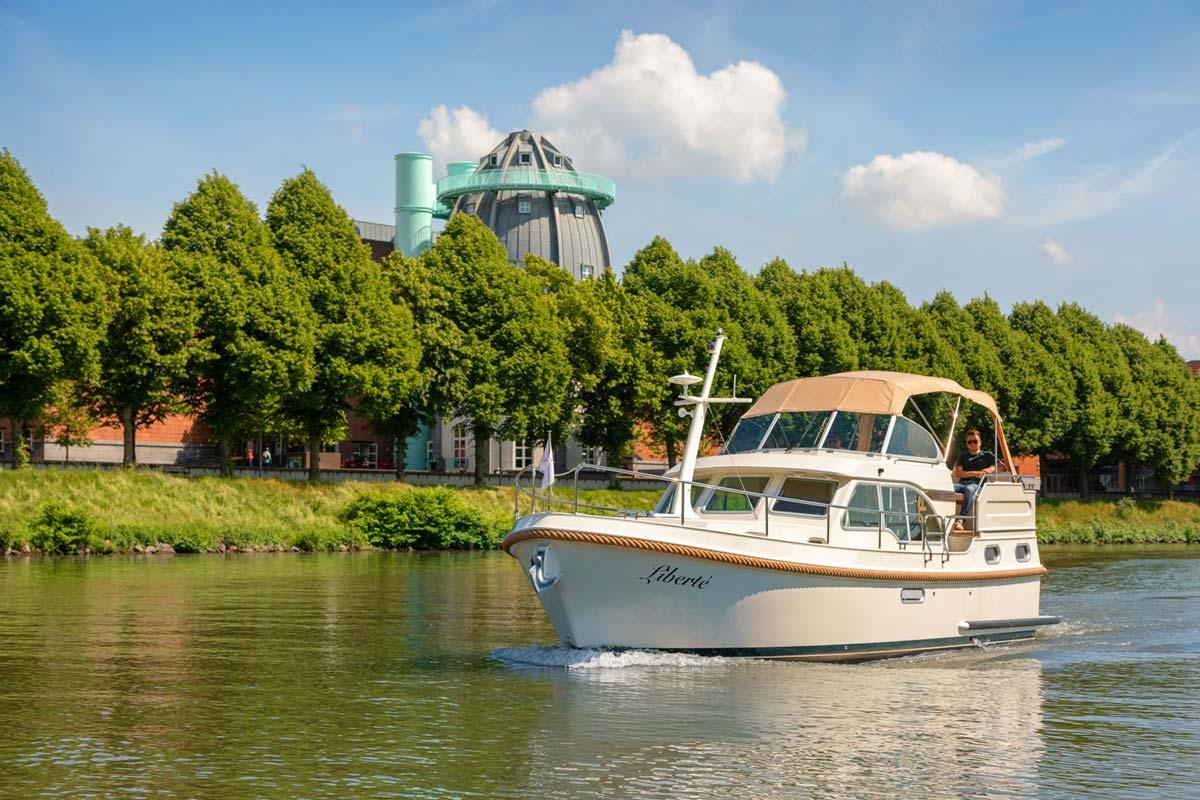 Motorboat sailing in Dutch Limburg